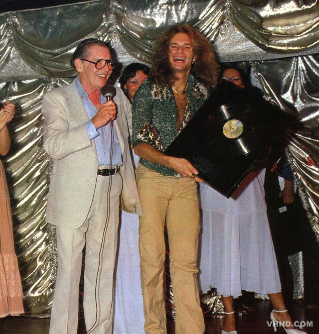 Van Halen's David Lee Roth receives a platinum album from Milton Berle, 1978
